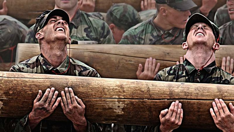 Navy SEALS candidates felling the pain on a log carry.
