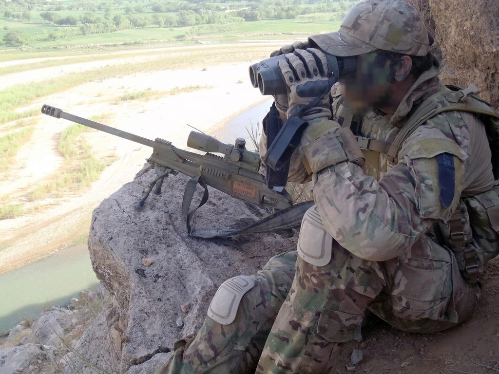 A sniper requires patience 2CDO sniper overlooks valley Photo: ADF