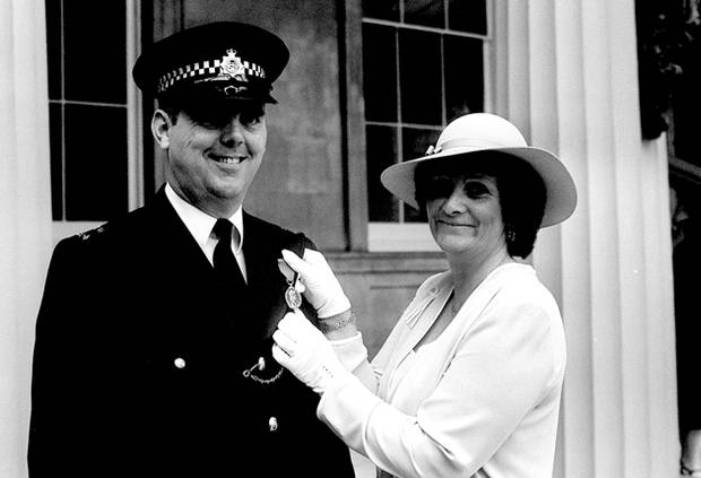 Honoured: PC Trevor Lock, with his wife, gets the George Medal in 1981 (Public Domain)