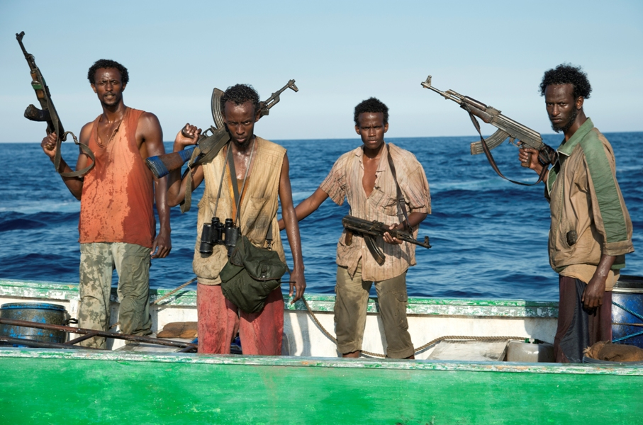 "This film image released by Sony - Columbia Pictures shows, from left, Faysal Ahmed, Barkhad Abdi, Barkhad Abdirahman, and Mahat Ali in ""Captain Phillips."" (AP Photo/Sony - Columbia Pictures, Jasin Boland)"